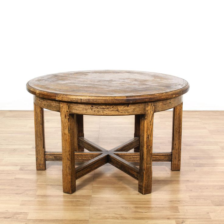 This dining table is featured in a solid wood with a distressed walnut finish. This country chic style kitchen table has a pentagonal stretcher base, sturdy legs, and round top. Perfect for casual or formal dining! #countryfarmhouse #tables #diningset #sandiegovintage #vintagefurniture