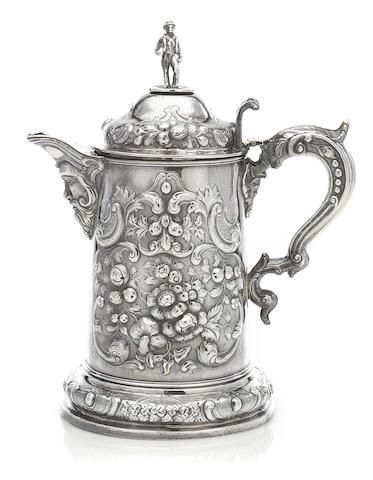 A Victorian sterling silver repousse-decorated trophy pitcher: of yachting interest maker's mark rubbed, Dublin 1865
