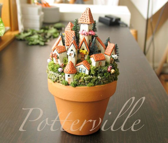 Fairy Village of Potterville  -  Miniature Medieval Walled City of Houses and Towers - Terracotta Pot with Flowers, Mushrooms and Pine Trees