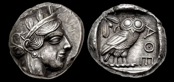 Greek silver tetradrachm of Athens (Attica) Obverse: Helmeted head of Athena right, with frontal eye.  Reverse: Owl standing right, head facing; olive sprig and crescent behind; all within incuse square.