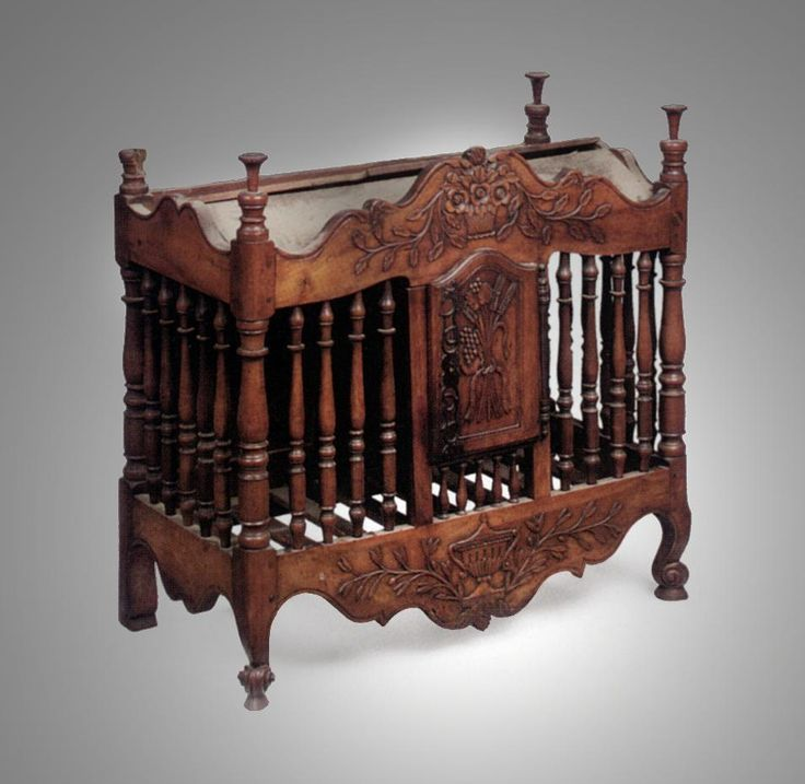 A Provincial Carved and Turned Walnut Pannetière  French, Circa 1830.