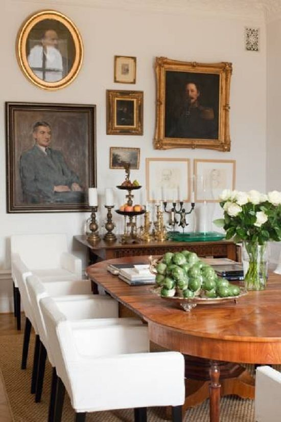 Adore the art arrangement on the wall! Great balance of small/large, round/square. Smart, smart.