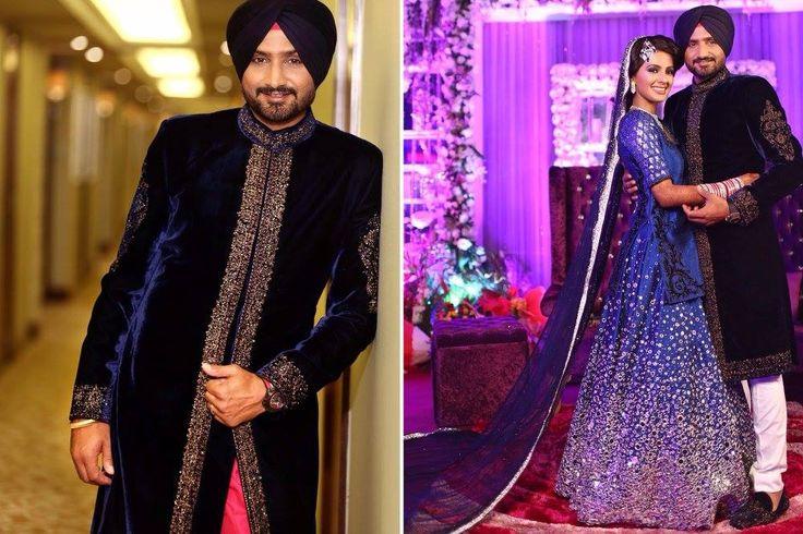 A midnight blue velvet sherwani with a gold embroidered border for groom Harbhajan Singh. Photo Courtesy- Israni Photography #WeddingSutra #groom #indiangrooms #wedding #indianwedding #Indian #sherwani #blue #velvet #gold