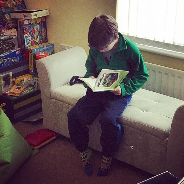 First thing on a Sunday morning and Alex is engrossed in his Minecraft books