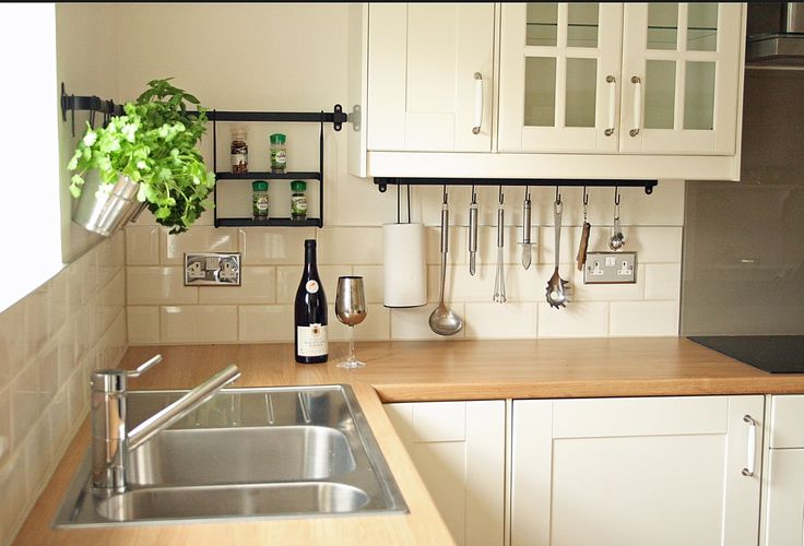 Oak worktop contrasting with cream cupboards and brick style tiles