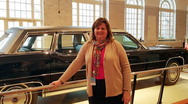 Our tour guide Sharon next to Regan's 1972 Presidential Limo. The Henry Ford Museum
