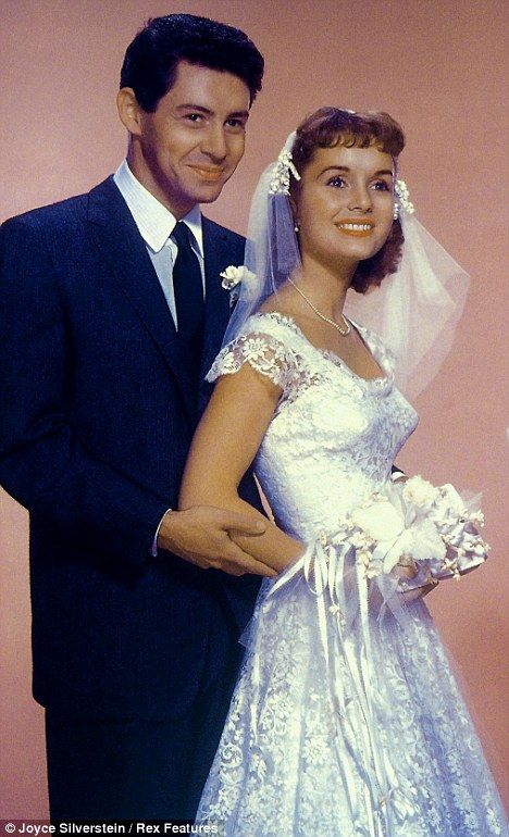 First love: Eddie Fisher with his first wife, actress Debbie Reynolds, on their wedding day in 1955