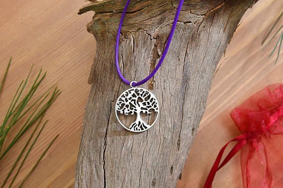 Check out this item in my Etsy shop https://www.etsy.com/listing/526950759/tree-of-life-waxed-string-necklace-charm