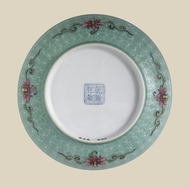 Saucer-shaped fine thin white porcelain dish. Decorated 'Gu Yue' style in 'famille rose' enamels. Inside is a delicately drawn design of blossoming magnolia and peach spray together with a poetical inscription with three seals in red enamel. Pair with PDF 857.