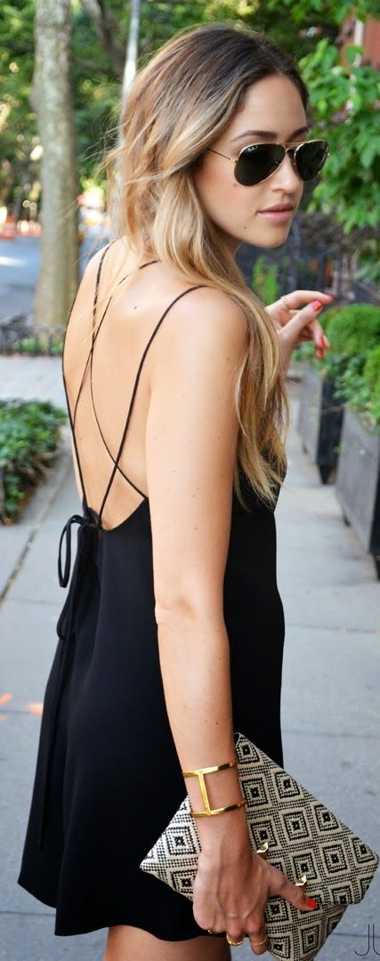 This aztec bag with the plain black dress is gorgeous, a touch of pattern