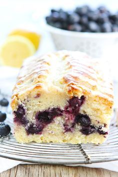 Lemon Blueberry Loaf Cake Recipe on twopeasandtheirpod.com This easy lemon loaf cake is bursting with blueberries! It is the perfect dessert for spring and summer!