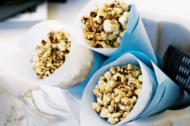 Indian-spiced popcorn. Lightly seasoned home-popped corn is a healthy alternative to high-fat snacks.