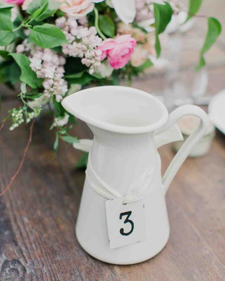 Browse through our table number ideas to create reception tables that are anything but ordinary.