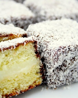 Lamingtons filled with Vanilla Custard -- These delectable morsels are best sellers at Australian bake sales and a great accompaniment to afternoon tea.