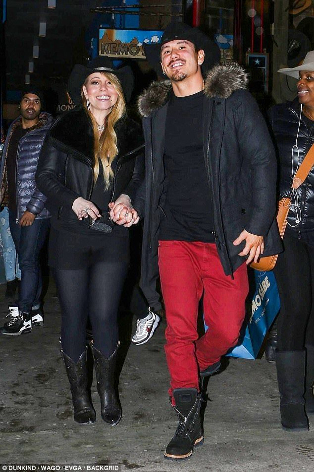 City-slicker chic:Mariah Carey seemed to have moved on from feeling festive and was instead embracing a cowboy theme as she headed out in Aspen with Bryan Tanaka on Thursday