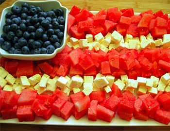 Fruit Flag - cannot be more patriotic!     Seedless watermelon, cut into bite size pieces. Feta/swiss/motzarella cheese cubes. One pint blueberry (poor into whilte bowl). Arrange watermelon and cheese in alternating rows on a medium/large rectangular serving plate. Have party toothpicks on the side for easy pick up. Enjoy!