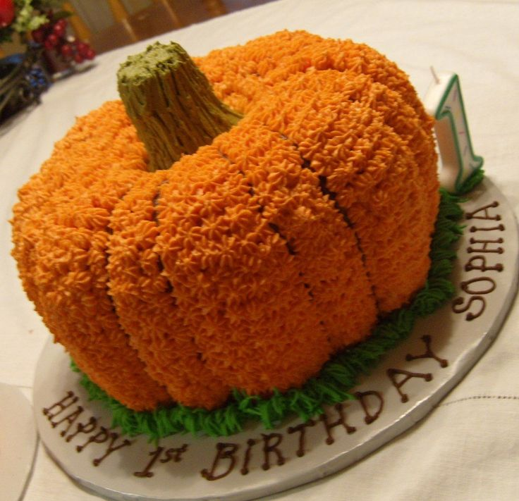 Pumpkin 1st Birthday Cake - Made with two bundt cakes - stem is BC frosted ice cream cone, cut to fit. Cake is vanilla with colored BC.  Also made a personal smash jack-o-lantern cake for the birthday girl - shown in a separate picture.