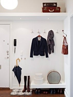 Top shelf for accessories, hooks for coats, lower hooks for bags, lower shelf for shoes. Works when you have a high ceiling!