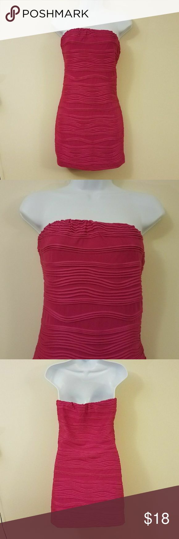 """Heart Soul Fuschia Textured Strapless Tube Dress HEART SOUL Women's Jr. Fuschia Pink Textured Strapless Tube Dress. Gently used. No Flaws. Size Large. Please see all photos for specifics.  Length: 25.5"""" Armpit to Armpit: 15""""  Measurements are taken laying flat and not stretched.  Thank you for your business! HeartSoul Dresses Strapless"""
