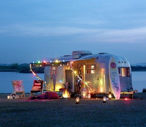 Airstream, I'll get one of these, park it and use it as an art studio, then do shows with it - use it as a mobile studio! :)