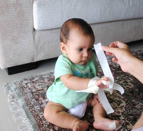 babies love tape.. painters tape is less sticky on baby's skin