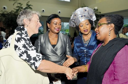 Ambassador Paola Amadei (left), head of delegation for the European Union to Jamaica, greets Professor Rhoda Reddock, deputy principal of the UWI St Augustine Campus, while Minna Israel (2nd left), special advisor to the UWI vice-chancellor on resource development, and Professor Verene Shepherd, director of the Institute for Gender and Development Studies (IGDS), look on. Occasion was the launch of the IGDS 20th anniversary exhibition on the UWI Mona campus.