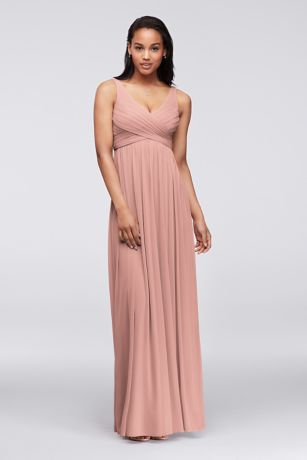 A long and breezy dress that will flatter any silhouette!  Sleeveless tank pleated bodice with ultra-feminine v-neckline features swooping cowl back detail.  Long