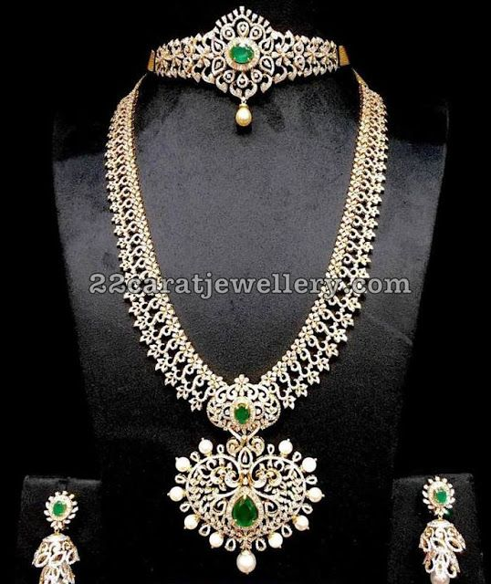 Splendid Diamond Wedding Sets Indulge yourself with these opulent diamond jewellery, An exclusive collection of Musaddilal Jewellwers, Featuring diamond long chain with very neatly crafted flower design, heart shaped two step designer pendant merged in the center with colorful emeralds. 2 in 1 diamond choker cum arm band with changeable center stones and broad back chain. Teamed up with simple yet trendy two step diamond jhumkas