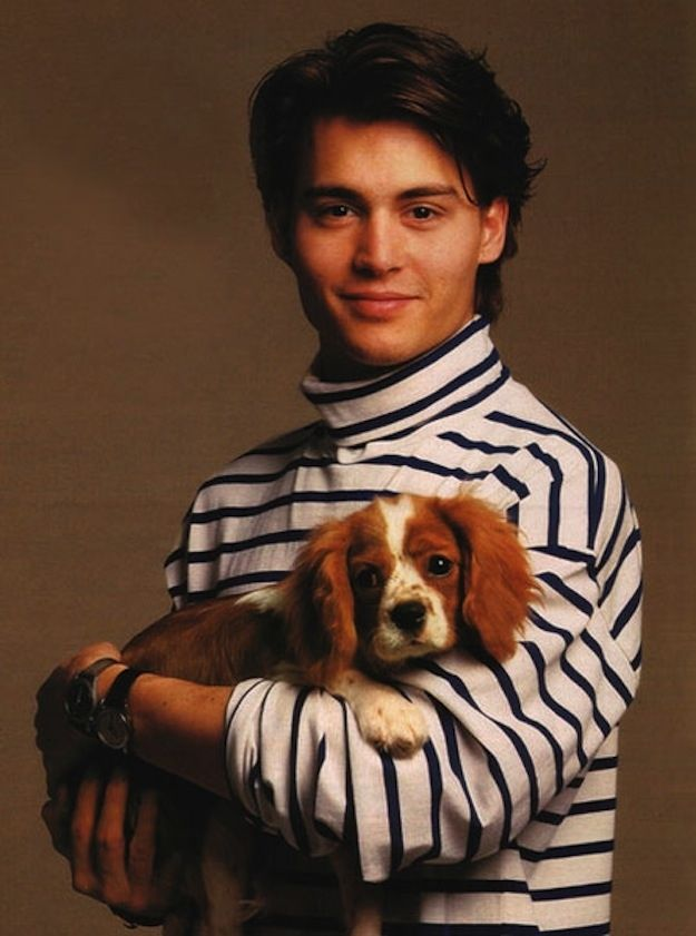 That time he wore this turtleneck PLUS held a dog. Johnny Depp's Awesomely Bizarre Photography Past.