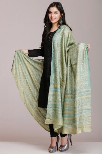 Sea Green Hand Block Printed Tussar Silk Dupatta over a black cotton suit