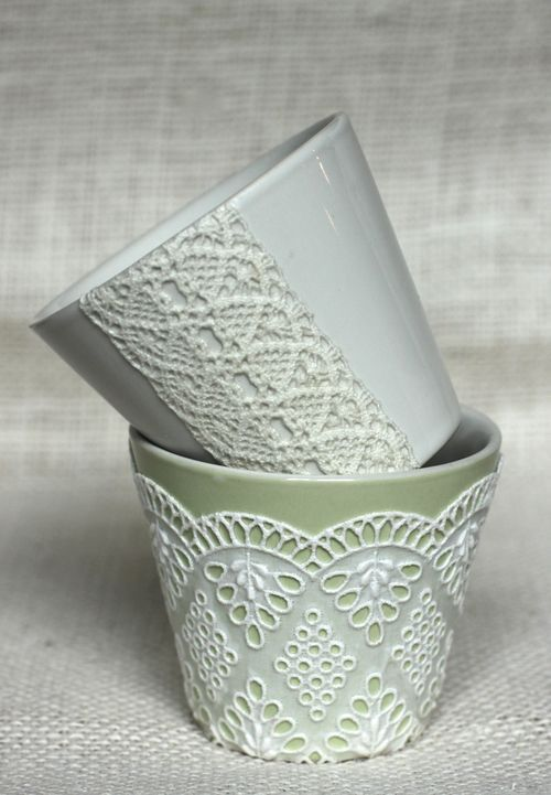 Painted terra cotta pot with acrylic paint, then glue lace or doily and finish by spraying with a semi-gloss sealing spray