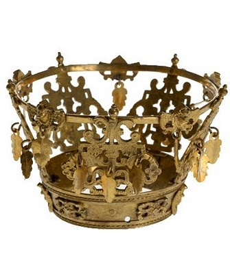 In Norway all brides wore some kind of special headdress.  In the south and east of the country it was usually made  of cloth or other material, smothered with ribbons, beads  and silver appliqués. Bridal crowns were mainly used in  the west of Norway. These crowns are full of symbolic  values. The crown itself recalls the crown of the Virgin,  and represents purity or virginity.