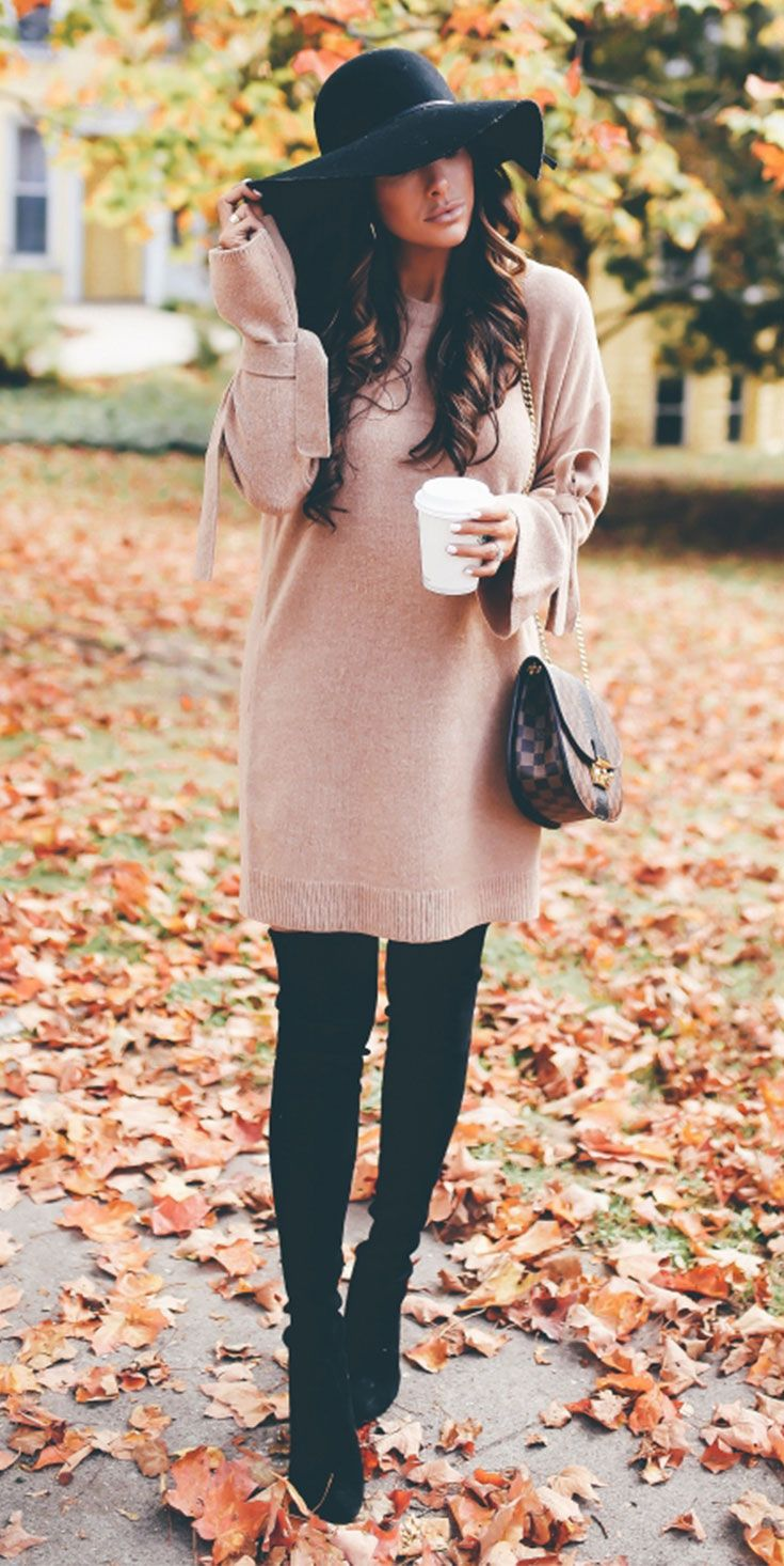 This is from our visit to Michigan in October. We were in Traverse City – it was fall weather at the time but this outfit would be great if you are in winter weather as long as you've got a coat when you head outdoors.   Sweater Dress | OTK Boots | Floppy Hat | The Sweetest Thing Blog | Emily Ann Gemma | #Fallfashion #falloutfit #fallstyle #thanksgiving