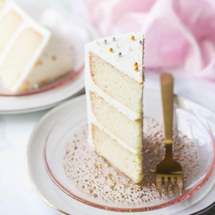 Triple Layer Slice Of White Almond Sour Cream Cake On A Pink Plate Sour Cream Cake White Cake Recipe Easy Cake Recipes