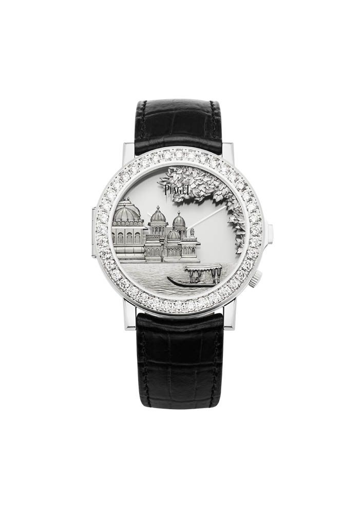 Piaget Altiplano Double Jeu Gold Engraving  One watch, two cases with 18-carat white gold case set with 40 brilliant-cut diamonds. In the upper case there is a hand-engraved Indian landscape in white gold. In the Lower case: Mythical Journey logo engraved on the case back Silvered dial Manufacture Piaget 830P, ultra-thin hand-wound mechanical movement. #Piaget #amythicaljourney #diamonds