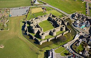 Beaumaris Castle: Located in Wales it is the last and largest castle to be built by King Edward I in 1295. It is one of Britain's most sophisticated medieval military architecture. Beaumaris Castle is almost completly symmetric.