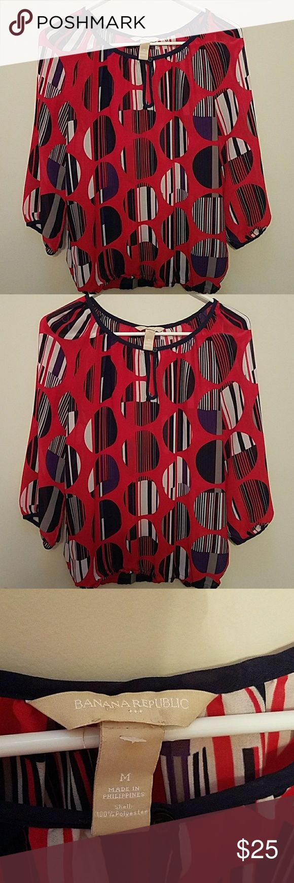 Banana Republic women blouse Beautiful Banana Republic women peasant blouse. Circles pattern all over. Career and casual wear. 100%  polyester. Hole button closure on the front. Very thin. Stretch at the hem Banana Republic Tops Blouses