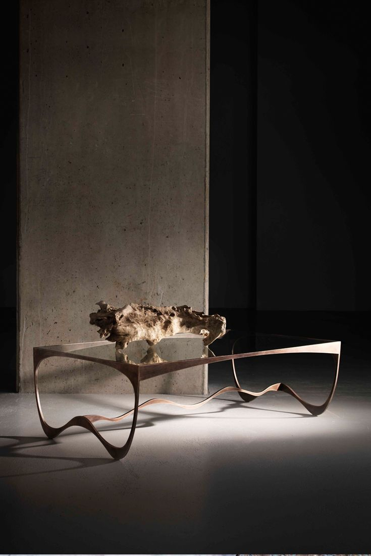 The Memphis #coffee_table made of #metal and finished in #antique_bronze with a #glass top.