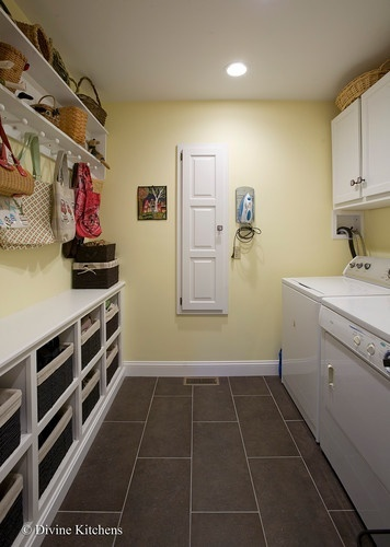 This is similar to mine. I like that one wall is shelving and drawers and the other side is the washer/dryer.