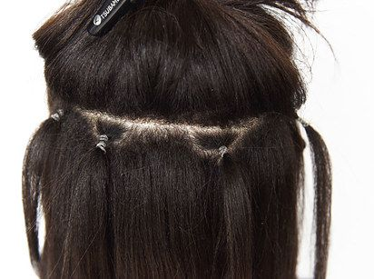 The hairstylist blew everyone's minds when she hid teeny ponytails in our hair and then clipped extensions onto the ponytails' elastics.