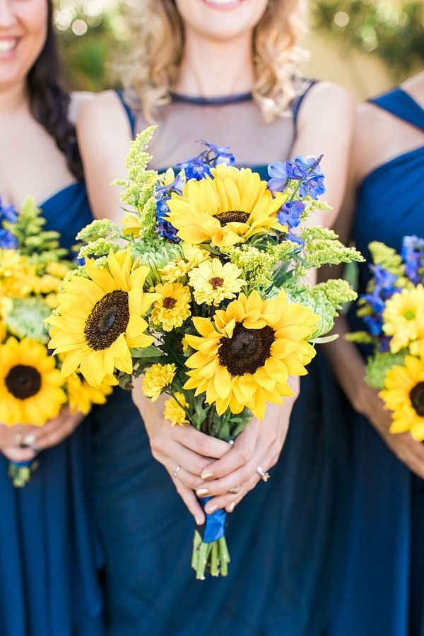 A great big dose of happy in this navy and yellow rustic sunflower wedding from Rachel Solomon Photography!!