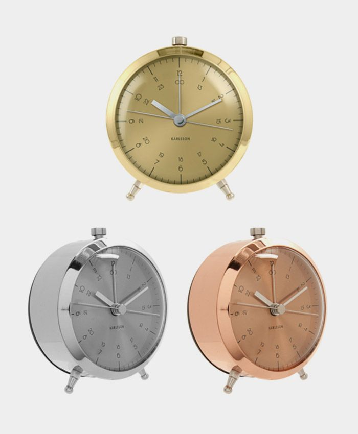 Alarm clock named Button. Avaible in brass, copper and steel plated. a sophisticatedd  and playfulll design. Nice details are the silent movement, aluminium dial and a second hand sticking out on both sides.