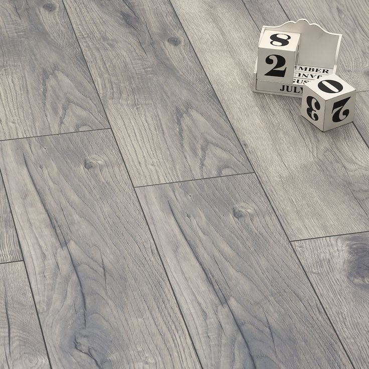 The beloved features and character of natural wood are recreated in a high quality laminate form to make the Manor Peterson Oak Grey stand out from other designs. Offering an accurate interpretation of solid oak, floor comes with a realistic wood effect texture, embossed finish, and V-groove edging.  Hard-wearing and durable as well as practical and easy to maintain, the planks will perfectly suit a modern family home. An anti-bacterial coating inhibits the growth of germs and bacteria…
