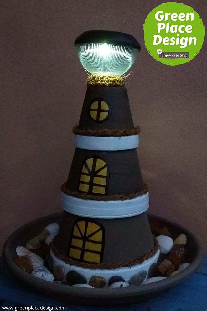 How to make a #clay pot #lighthouse in 4 easy steps | Green Place Design  Keep the #summer feeling all year long. Bright up your yard and create a bit of #nautical feeling with a clay pot lighthouse made by you. It's such a fun and easy #project to do!  #decor #design #decorideas #tips #decortips #diyproject #easydiy #diyidea #inspiration #handmade #homedecor #decoration #design #inspiration #decoridea #crafts #diyproject #diydecorating #diycrafts #diytutorial #cheaphomedecor #easyhomedecor
