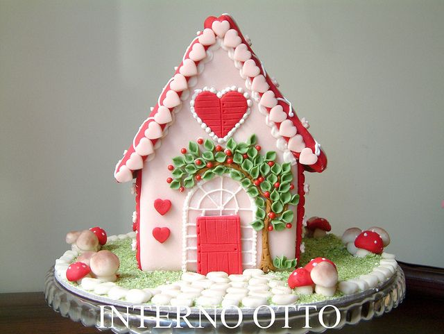 little gingerbread house in the forest.  I love the tree arching over the door!