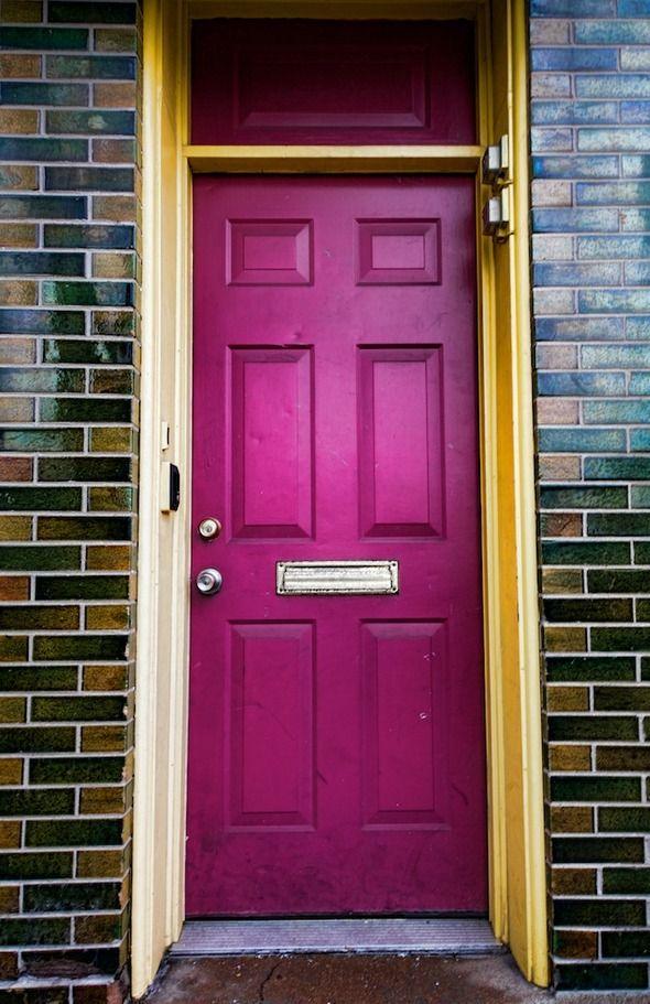 Love this bright raspberry colored door in NY.