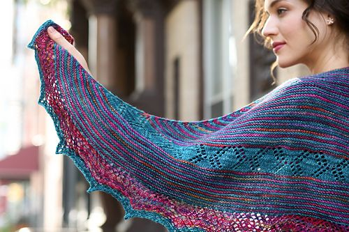 A lovely asymmetrical triangle knit from a small point with easy texture and light lace. Stitches are bound off every few rows to create the stair-stepped edge.