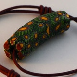 """This one-of-a-kind, mosaic """"Watermelon Millifiori"""" (thousand flowers) glass bead was hand made over 100 years ago and exclusive to World Hippie Originals."""