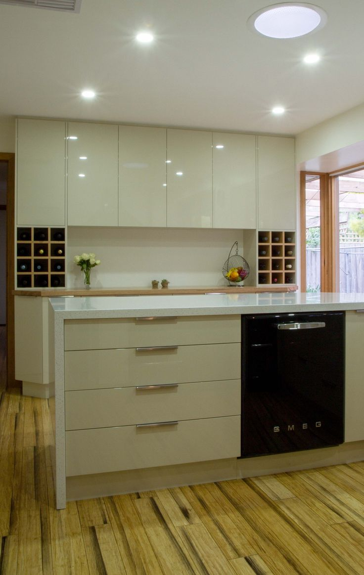 Small contemporary kitchen with bar buffet and return bench for breakfast bar seating. www.thekitchendesigncentre.com.au