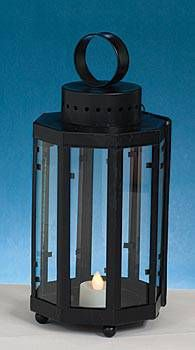 This pretty nautical lantern centerpiece is an affordable way to decorate party tables, while enclosing tealights.